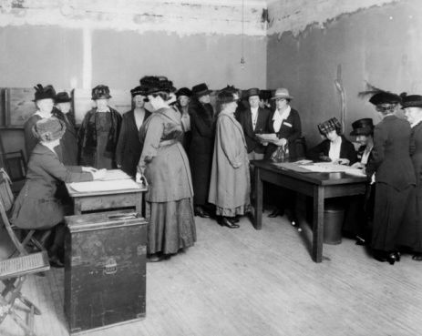 High angle view of a group of suffragettes in an office